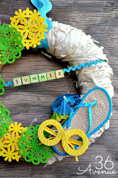 Summer Wreath Tutorial from the36thavenue.com It was made with items from the Dollar Store.