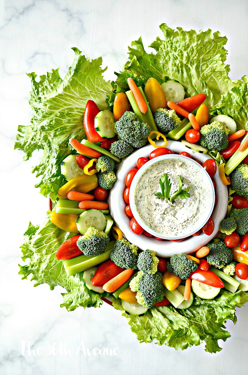 Veggie Wreath and dips. This vegetable wreath is perfect for parties and holidays.