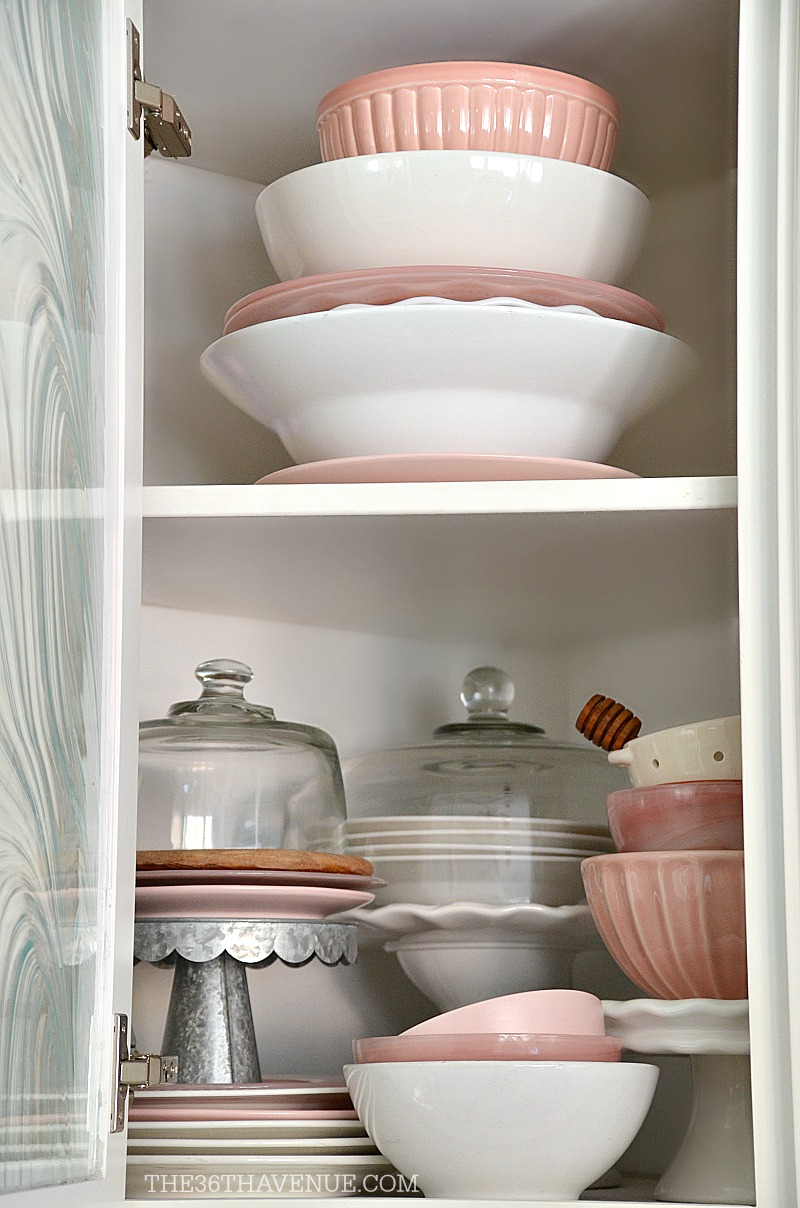 White kitchen decor ideas and how to decorate with pink accents.